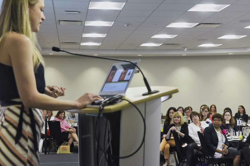 Women listen as Lisa Burton, executive director of HearstLab delivers the keynote address at the Women@Work 3rd annual Summit at the Hearst Media Center on Wednesday, June 5, 2019, in Colonie, N.Y. (Paul Buckowski/Times Union)
