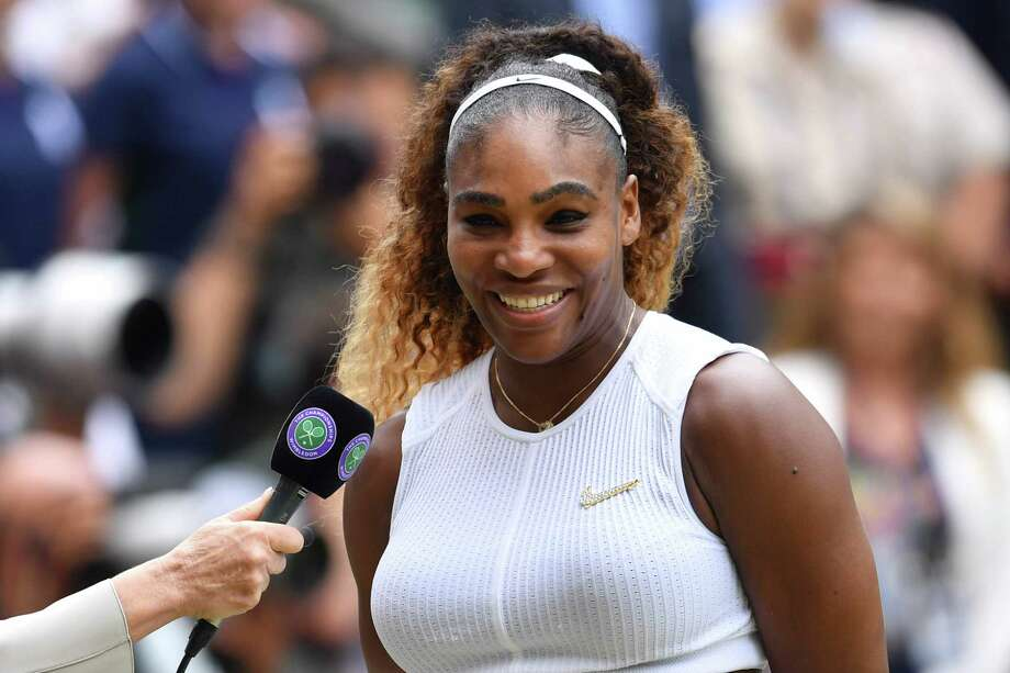 US player Serena Williams is interviewed during the presentation after losing against Romania's Simona Halep during their women's singles final on day twelve of the 2019 Wimbledon Championships at The All England Lawn Tennis Club in Wimbledon, southwest London, on July 13, 2019. (Photo by Glyn KIRK / AFP) / RESTRICTED TO EDITORIAL USEGLYN KIRK/AFP/Getty Images Photo: GLYN KIRK / AFP or licensors