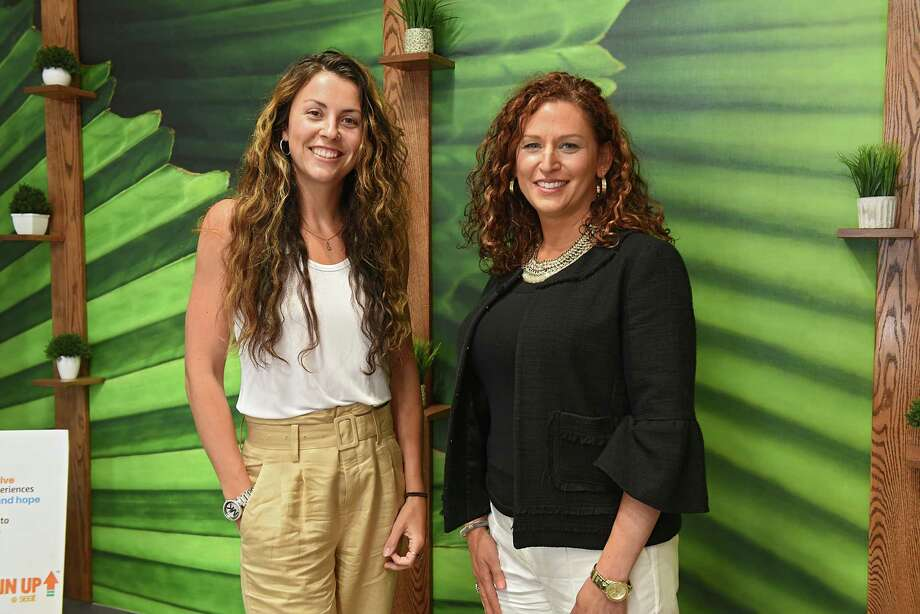 Emily Dessingue, former business development manager for Cresa, left, and Jennifer Lawrence, executive director of Social Enterprise and Training Center (SEAT) stand in a conference room at the SEAT Center on Tuesday, July 23, 2019 in Schenectady, N.Y. As of mid-August, Emily has accepted a position at the center.  (Lori Van Buren/Times Union) Photo: Lori Van Buren / 20047427A