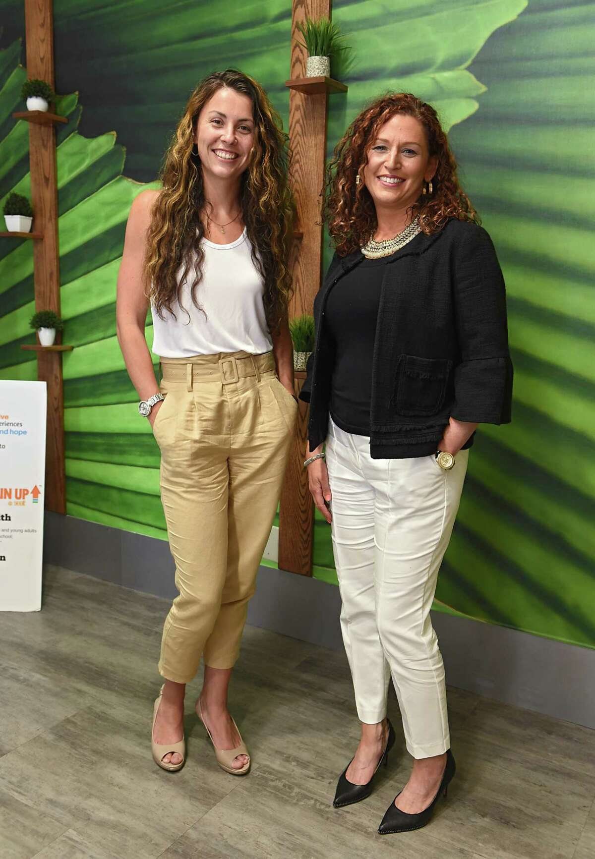Emily Dessingue, former business development manager for Cresa, left, and Jennifer Lawrence, executive director of Social Enterprise and Training Center (SEAT) stand in a conference room at the SEAT Center on Tuesday, July 23, 2019 in Schenectady, N.Y. As of mid-August, Emily has accepted a position at the center. (Lori Van Buren/Times Union)