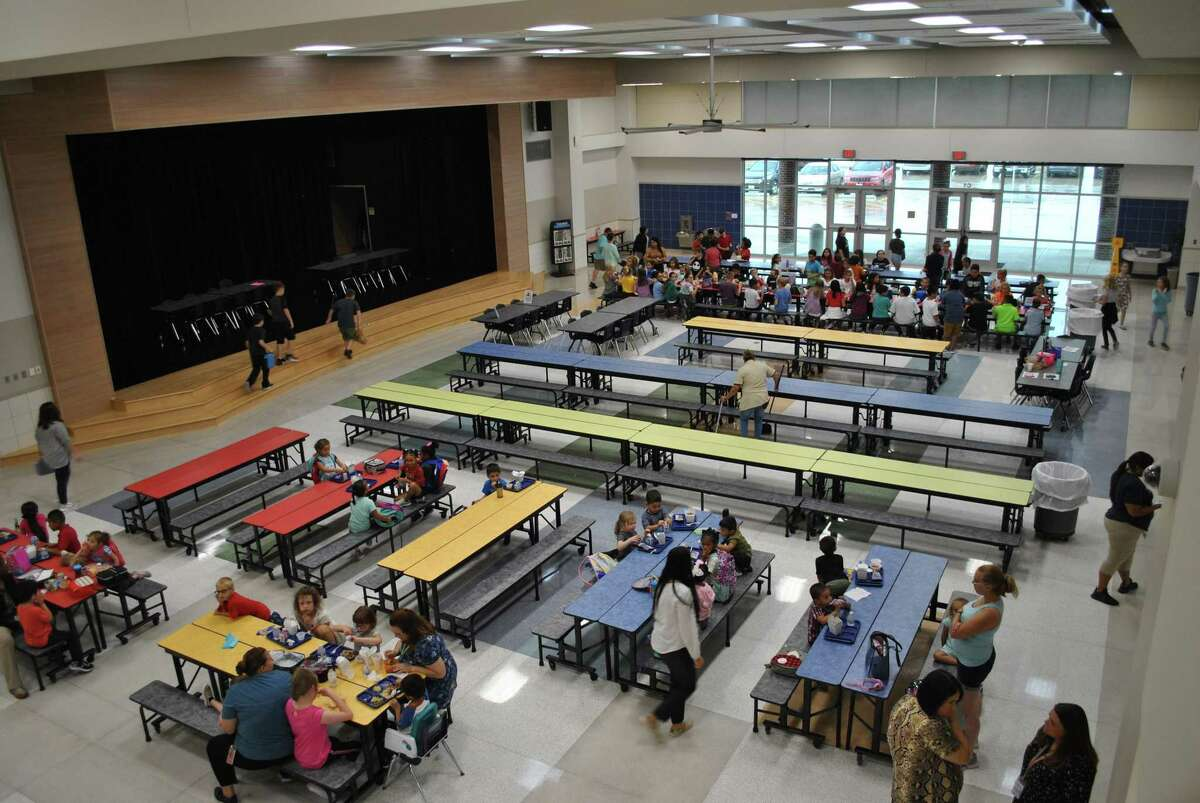 Students at the new Bob and Betty Nelson Elementary head to the cafeteria for brain food.