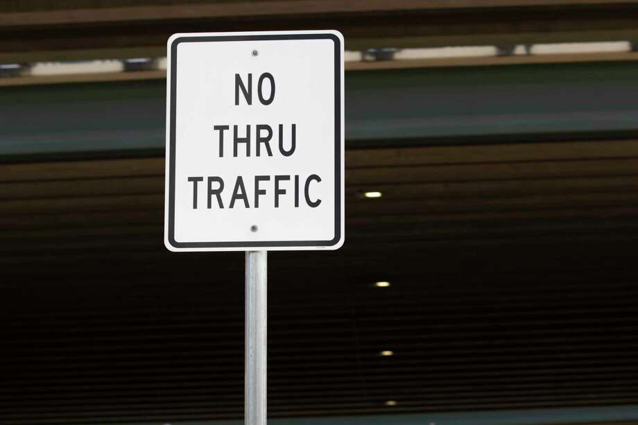 A traffic sign has been placed near the Conroe Park and Ride signaling thru traffic is restricted to drivers Tuesday, August 20, 2019 on the southbound side of Interstate 45 in Conroe. Photo: Cody Bahn, Houston Chronicle / Staff Photographer / © 2019 Houston Chronicle