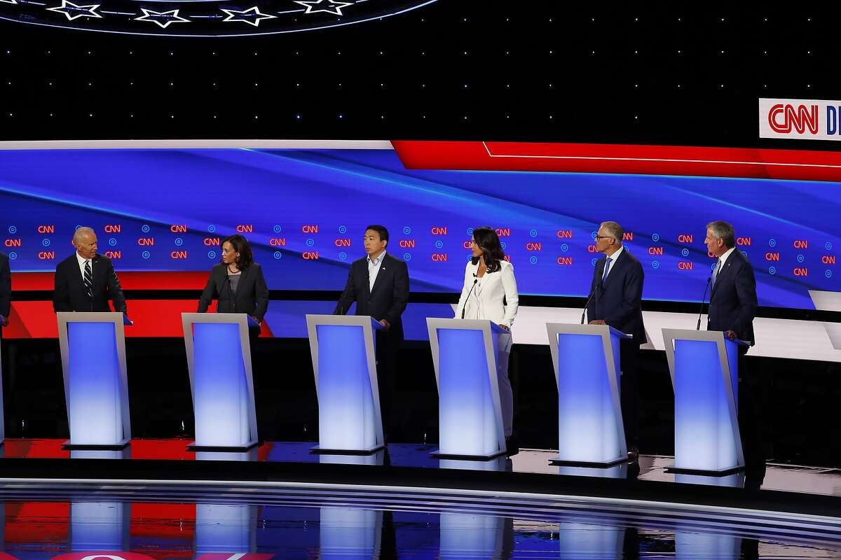 Former Vice President Joe Biden, from left, Sen. Kamala Harris, D-Calif., Andrew Yang, Rep. Tulsi Gabbard, D-Hawaii, Washington Gov. Jay Inslee and New York City Mayor Bill de Blasio participate in the second of two Democratic presidential primary debates hosted by CNN, July 31, 2019, in the Fox Theatre in Detroit. (AP Photo/Paul Sancya)
