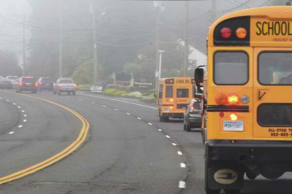 Spectrum/New Milford students headed back to school Tuesday, Aug. 27, 2019. A familiar scene once the school year starts, traffic backs up along Route 7 in front of Italia Mia so a bus can pick up students at Willow Springs near the Windmill Diner ahead.