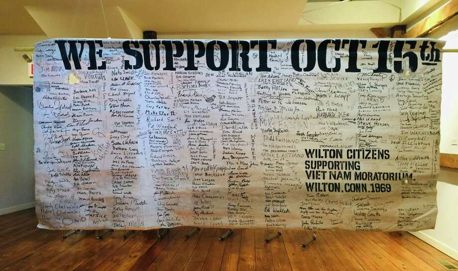 A protest banner in support of the Oct. 15, 1969 national moratorium on the Vietnam War, is on display at the Wilton Historical Society. The banner was signed in Wilton by more than 400 people of all ages. Photo: Contributed Photo / / Wilton Bulletin Contributed