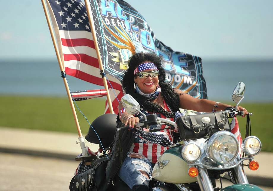 Myrna Vivo, of Bridgeport, arrives in Seaside Park along with hundreds of motorcycle riders participating in the 2017 CT United Ride in Bridgeport, Conn. on Sunday, September 10, 2017. Along with the American flag, Vivo's motorcycle sported an Air Force flag in honor of her children. Her son serves in the U.S. Air Force and her daughter is in the Air Force ROTC. Photo: Brian A. Pounds / Hearst Connecticut Media / Connecticut Post