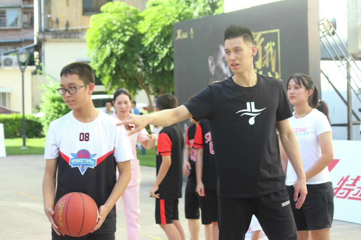 Basketball player Jeremy Lin (right) attends a basketball public welfare event on August 23, 2019 in Xiamen, Fujian Province of China.
