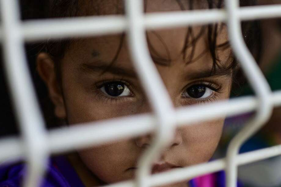 The Trump administration is moving forward with plans to detain immigrant families indefinitely, deny public education to immigrant children and make legal immigrants who use federal benefits ineligible for green cards and citizenship. Photo: Contributed Photo /AFP /Getty Images / AFP