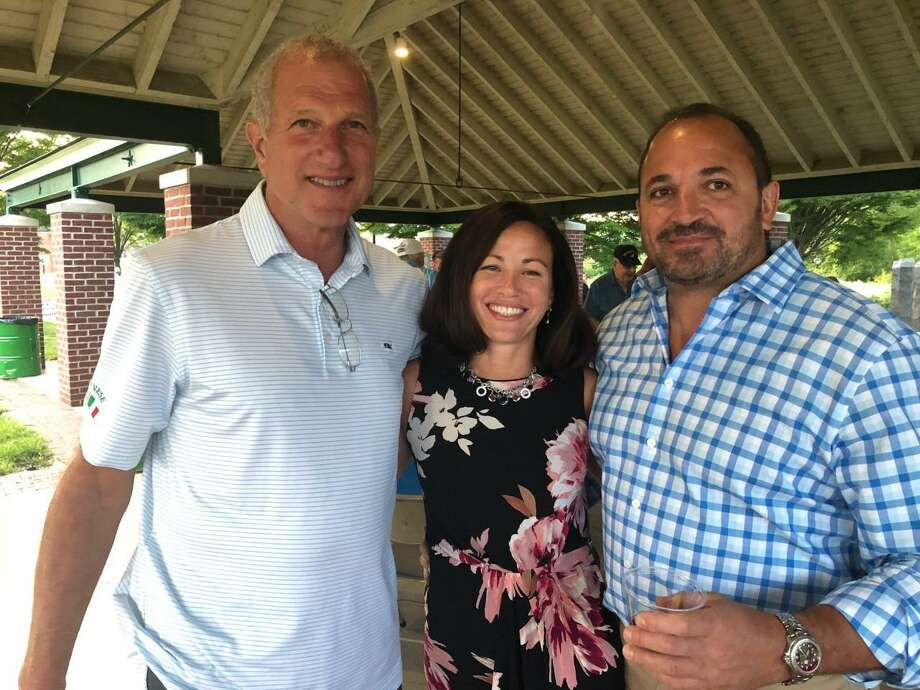 """Mayor Mark Lauretti with Republican Town Committee-endorsed Board of Education candidate Amy Romano and her husband, Mark, at the """"Republicans for Continued Tax Stability"""" River Walk fundraiser Monday, Aug. 26. Photo: Brian Gioiele / Hearst Connecticut Media / Connecticut Post"""