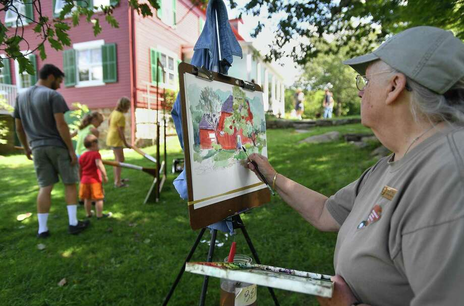 Artist Bobbi Eike Mullen, of Georgetown, paints during the Art in the Park Annual Festival last year at Weir Farm National Historic Site. The 2020 Art in t the Park contest is being held virtually. Photo: Brian Pounds /Hearst Connecticut Media / Connecticut Post