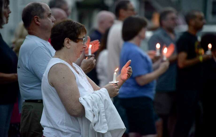 Anita Lucsky, of Danbury, holds a lit candle during The Heroin and Opiate Awareness Project (HERO) annual vigil to raise awareness of overdoses. Friday, August 31, 2018, at United Methodist Church, Bethel, Conn. Photo: H John Voorhees III / Hearst Connecticut Media / The News-Times