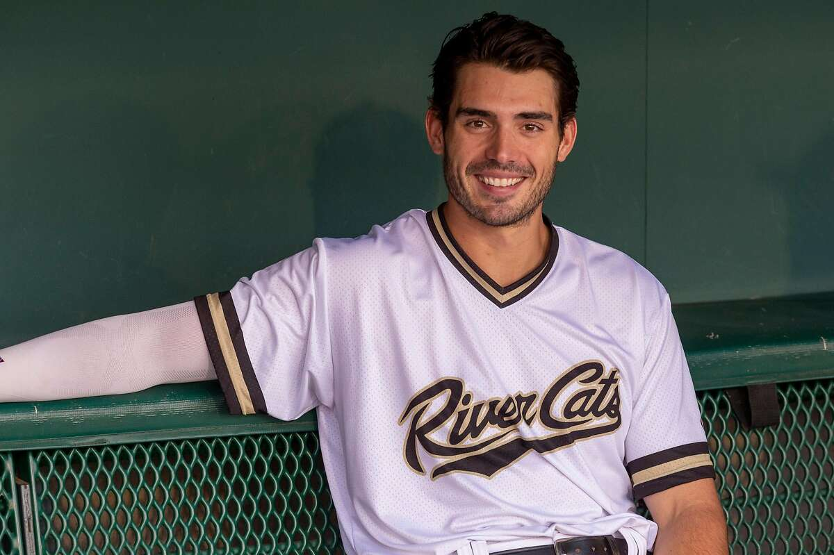 Sacramento River Cats first baseman Chris Shaw (18) sits in the dugout before their game against the Reno Aces at Raley Field, Monday Aug 26, 2019.