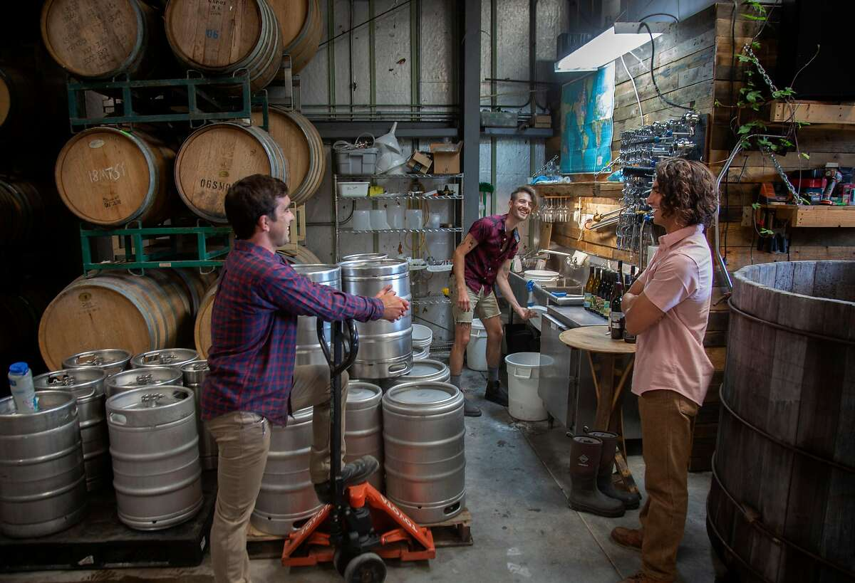 From left, winemakers Ryan Stirm, Brent Mayeaux and James Jelks chat at their shared winery near Aromas, California on Friday, 8/17, 2019. Four young