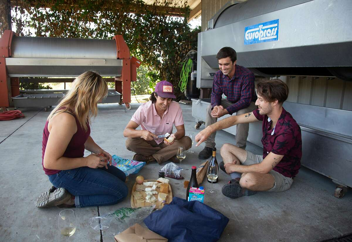 From left, winemakers Megan Bell, James Jelks, Ryan Stirm and Brent Mayeaux have lunch at their shared winery near Aromas, California on Friday, 8/17, 2019. The group of young
