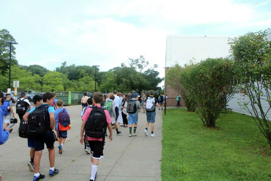 Students head in to Bedford Middle School to kick off the new school year. Taken Aug. 27, 2019 in Westport, CT. Photo: Lynandro Simmons /Hearst Connecticut Media