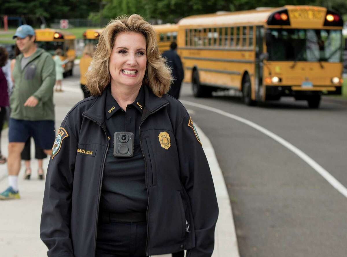 Wilton School Resource Officer Diane Maclean greeted Miller-Driscoll students on the first day of school on Aug. 27. She has announced her retirement effective Oct. 1.