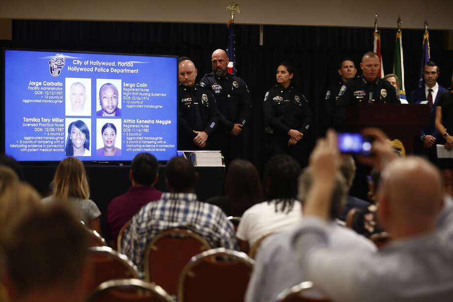 The images of the four defendants accused in the deaths of 12 people at a nursing home in Hollywood, Fla., in 2017 are shown during a police news conference announcing the charges. Photo: Brynn Anderson / Associated Press