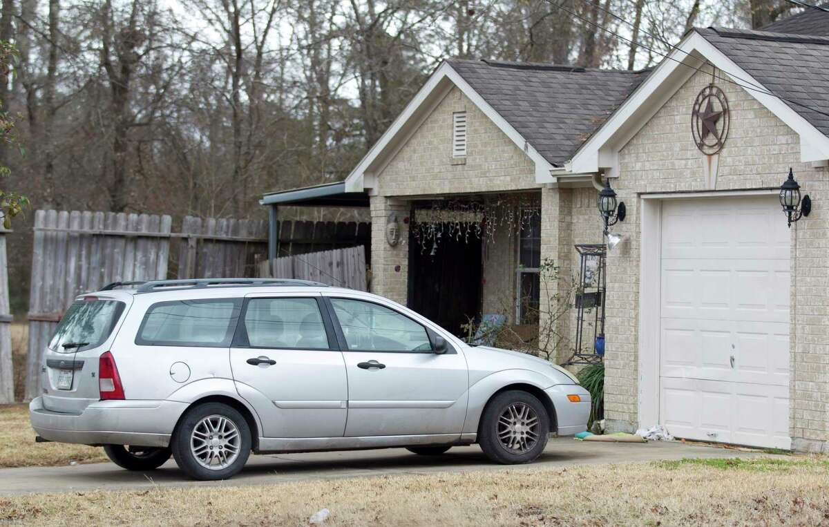 The home where a father and son were bound by a pair of men on Wednesday claiming cartel connections is seen Friday, Jan. 26, 2018, in Conroe. The father was taken away by the kidnappers and later killed Thursday morning during an FBI raid.