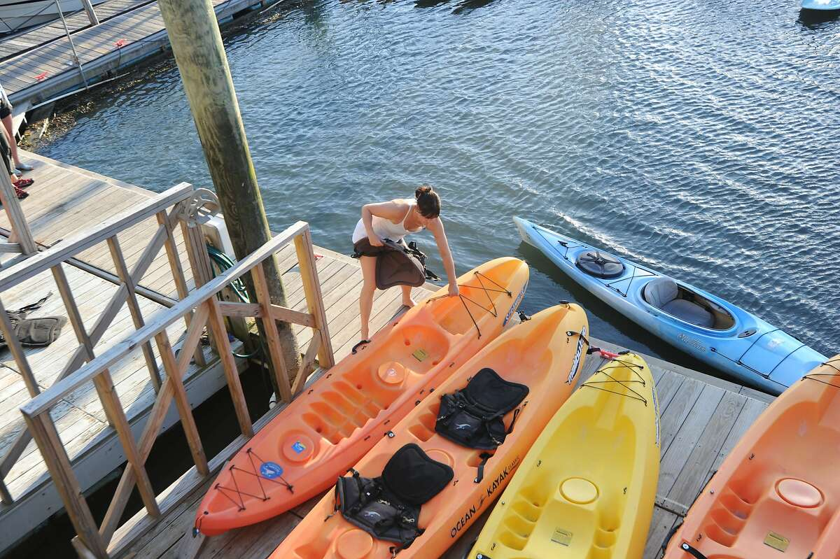 Kim Beaumont, owner of Rowayton's DownUnder Kayaking, prepares boats as she hosts a kayak paddle down the Five Mile River to benefit Westport's Earthplace and its Harbor Watch/River Watch program Wednesday, September 8, 2001.