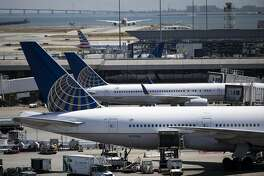 Two United Airlines Boeing 777-200 dock at Terminal 3 at San Francisco International Airport in San Francisco, Calif. on Monday, August 26, 2019.