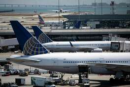 Two United Airlines Boeing 777-200 are docked at Terminal 3 at San Francisco International Airport in San Francisco, Calif. on Monday, August 26, 2019. A passenger on a United flight bound for Houston earlier this year pleaded guilty on Tuesday, Aug. 27, 2019, to video voyeurism.