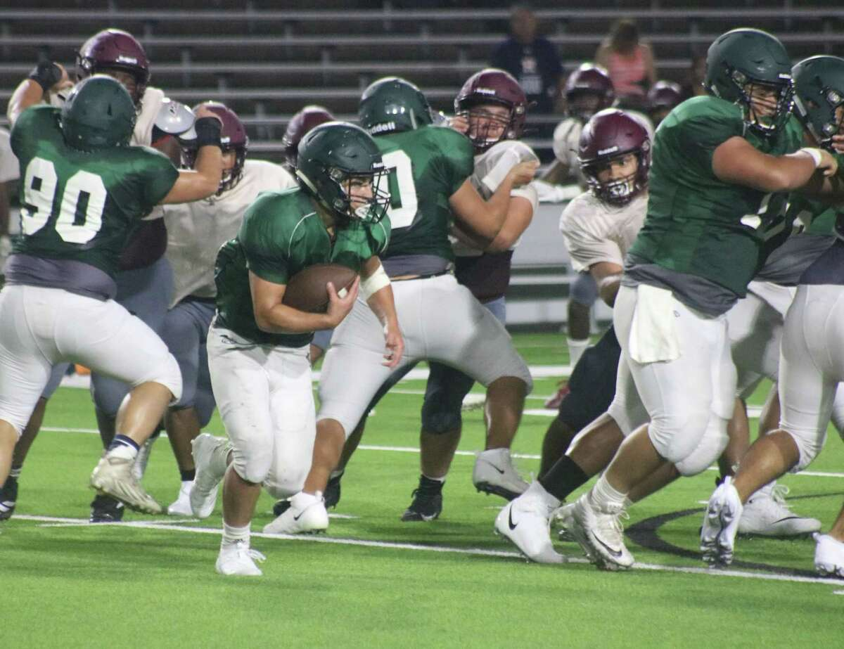 A Pasadena ballcarrier looks for a running lane during the Baytown Lee scrimmage. How bad has it been for Pasadena's offense in recent years? If the Eagles average only 12 points a game this year, it will be their most productive year since 2015.
