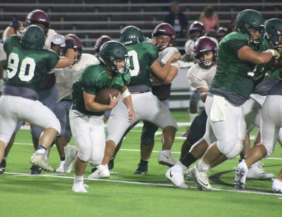 A Pasadena ballcarrier looks for a running lane during the Baytown Lee scrimmage. How bad has it been for Pasadena's offense in recent years? If the Eagles average only 12 points a game this year, it will be their most productive year since 2015. Photo: Robert Avery
