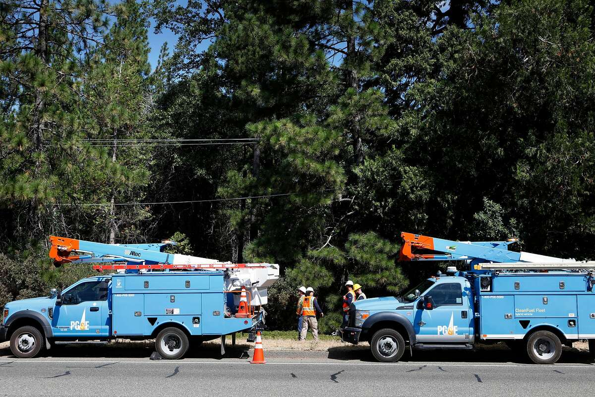 PG&E crews arrive and set up to repair a power line that had come loose from an insulator along Foresthill Rd., which was discovered during patrols in the area as PG&E performed a public safety power shutoff drill around Foresthill, Ca. on Thurs. August 8, 2019. Helicopters and trucks, are used in a trial run for how it will inspect power lines before turning them on after a shut down.