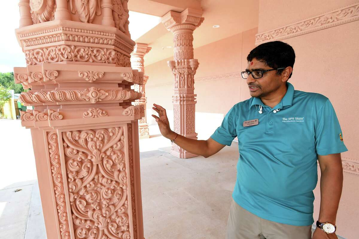 Nikul Patel talks about the design and durability of the pillars in front of the new Bochasanwasi Akshar Purushottam Swaminarayan Sanstha temple on Major Drive in Beaumont. The BAPS organization is a religious and social group within the Swaminarayan branch of Hinduism. Photo taken Wednesday, 8/14/19