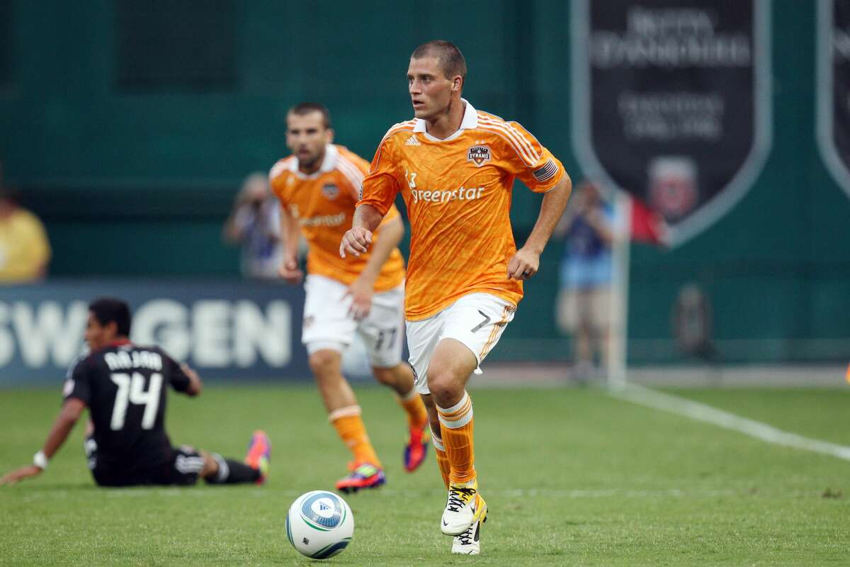WASHINGTON, DC - JUNE 25: Colin Clark #7 of the Houston Dynamo controls the ball against D.C. United at RFK Stadium on June 25, 2011 in Washington, DC. (Photo by Ned Dishman/Getty Images)