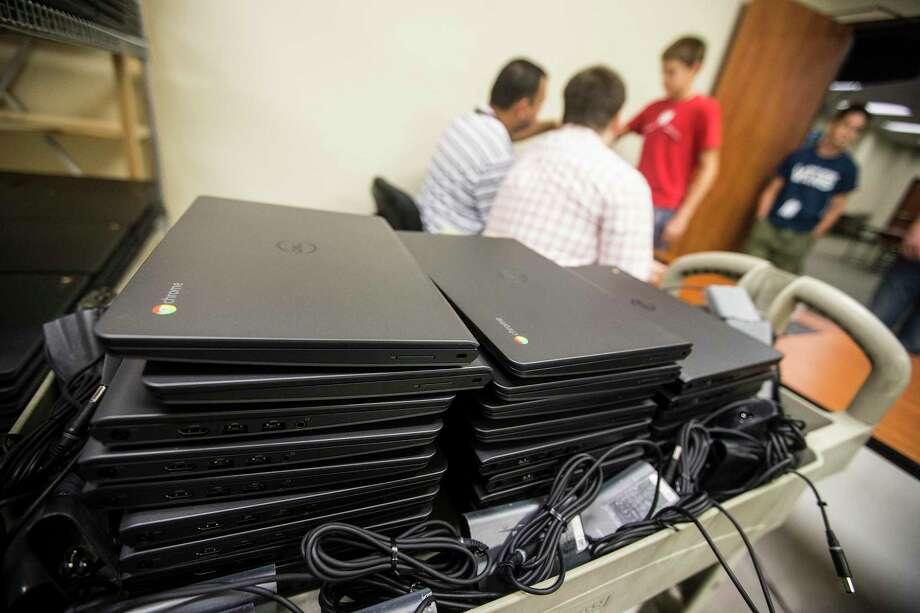 Increased technology in the classroom has expanded the tools available to educators, but it has also exposed new challenges to school distircts to protect staff and student information. Here, laptops are shown at New Caney ISD. Photo: ANDREW BUCKLEY / Internal