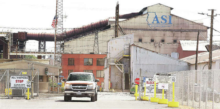 A truck pulls out of the main entrance to Alton Steel on Cut Street Tuesday after it was announced that salaried employees had puchased the facility.