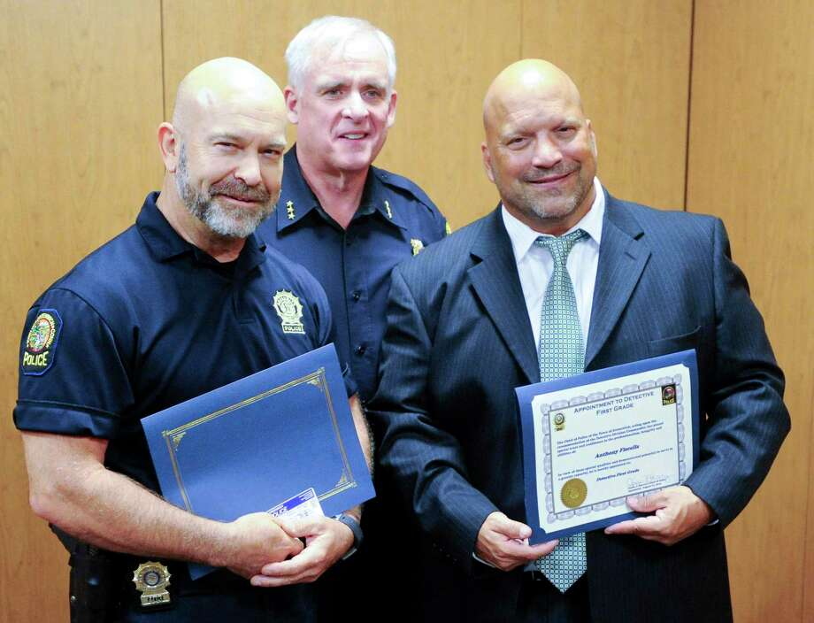 Greenwich Police Chief James Heavey, center, is photographed with newly appointed Detective First Grade William Weissauer, left, and Anthony Fiscella, at right, following a brief ceremony at the Greenwich Police Department on Tuesday August 27, 2019. Detective Mark Solomon, was also promoted to the rank of Detective First Grade but was special assignment and not able to attend the ceremony attended by family and fellow officers. Photo: Matthew Brown / Hearst Connecticut Media / Stamford Advocate