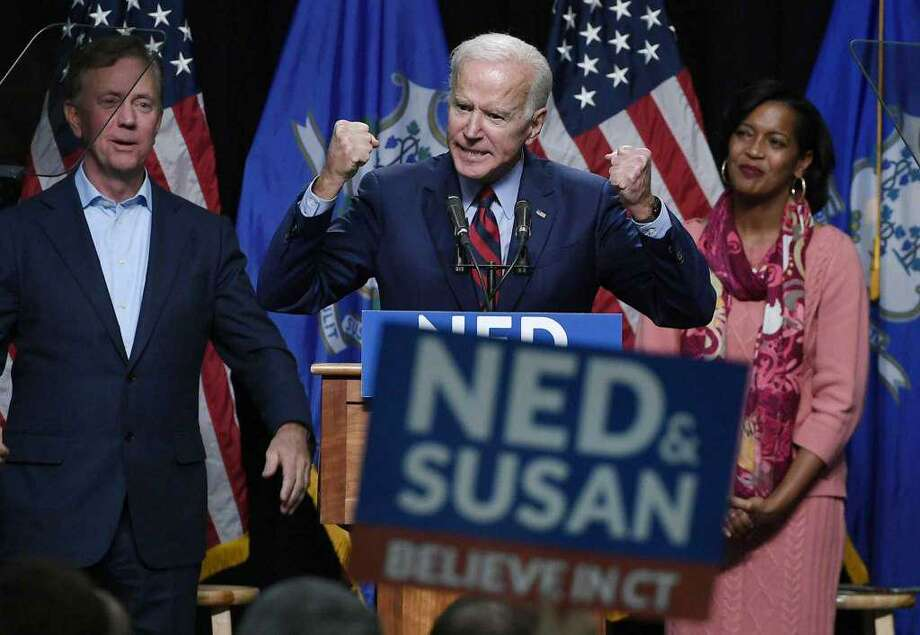 Former Vice President Joe Biden speaks at a rally supporting Democrats Ned Lamont for candidate for Governor, left, and Jahana Hayes, candidate for Congress, right, look on in Hartford, Conn., Friday, Oct. 26, 2018. Photo: AP Photo /Jessica Hill