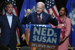 Former Vice President Joe Biden speaks at a rally supporting Democrats Ned Lamont for candidate for Governor, left, and Jahana Hayes, candidate for Congress, right, look on in Hartford, Conn., Friday, Oct. 26, 2018.