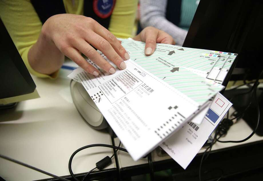 Voters receive their ballots in 2018 in San Francisco, Calif., where ranked-choice voting was used in th election. Photo: Liz Hafalia / The Chronicle / online_yes