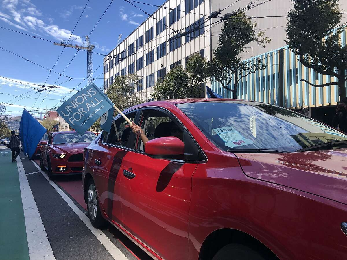 Around 100 Uber drivers protested outside the company's Market St. headquarters in San Francisco advocating for AB5 that could turn them from independent contractors to employees with protections and benefits on Tuesday, August 27, 2019.