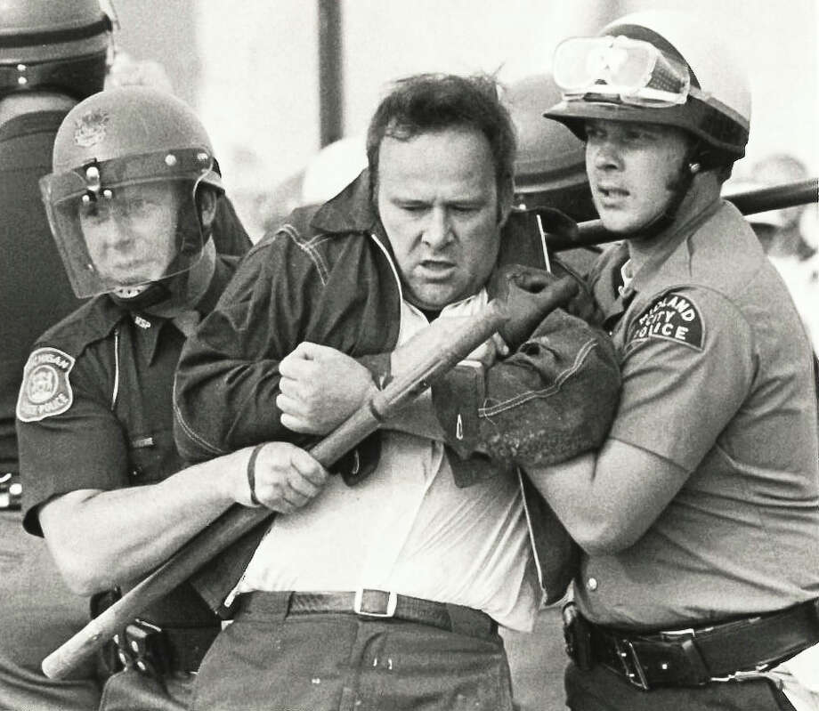 Midland City Police detain laborers. Construction workers are protesting Dow's use of non-union labor.September 1973 Photo: Daily News File Photo