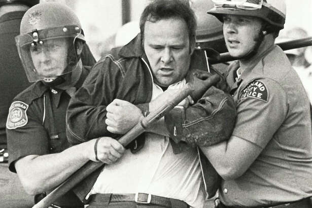 Midland City Police detain laborers. Construction workers are protesting Dow's use of non-union labor.September 1973