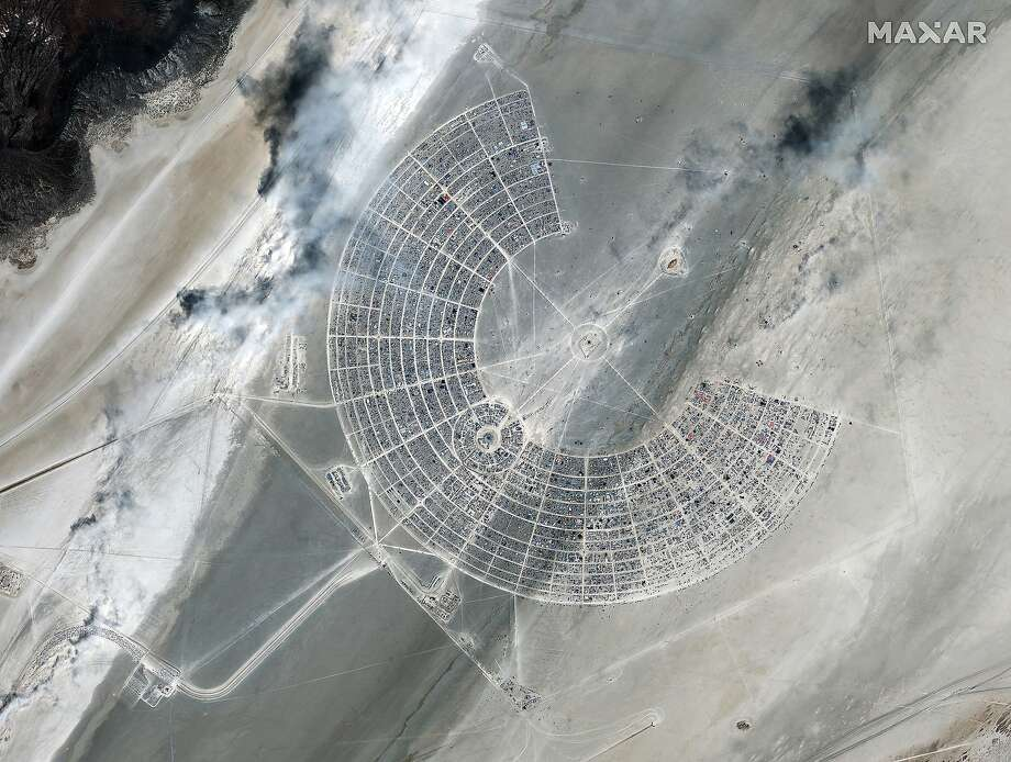This Sunday, Aug 25, 2019, satellite image provided by Satellite image �2019 Maxar Technologies shows a view over the Burning Man Festival in Gerlach, Nev. (Satellite image �2019 Maxar Technologies via AP) Photo: Associated Press
