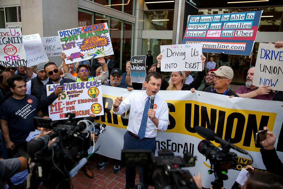 Presidential candidate Pete Buttigieg speaks during a protest outside of Uber's Headquarters on Market Street in San Francisco, Calif. on Tuesday, August 27, 2019. Tuesday's protest is part of a three-day drive from Los Angeles to Sacramento to advocate for bill AB5 that would classify gig workers as employees.