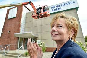 New Haven, Connecticut - Tuesday, August 27, 2019: Maureen Frank, president and CEO of New Haven Bank, with officials of the former Start Community Bank on the corner of Whalley Ave. and Sherman Ave. in New Haven unveil a sign Tuesday morning with the bank's new name, New Haven Bank.