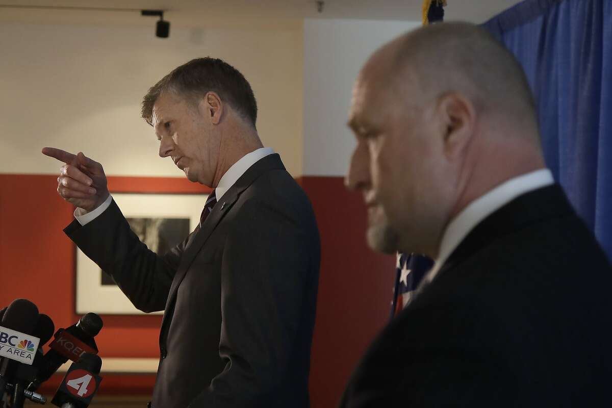 David L. Anderson, U.S. Attorney for the Northern District of California, left, gestures next to John F. Bennett, Special Agent in Charge, Federal Bureau of Investigation, as they speak at a news conference to announce charges against Anthony Levandowski at a federal courthouse in San Jose, Calif., Tuesday, Aug. 27, 2019. Levandowski, a former Google engineer, was charged Tuesday with stealing closely guarded secrets that he later sold to Uber as the ride-hailing service scrambled to catch up in the high-stakes race to build robotic vehicles. (AP Photo/Jeff Chiu)