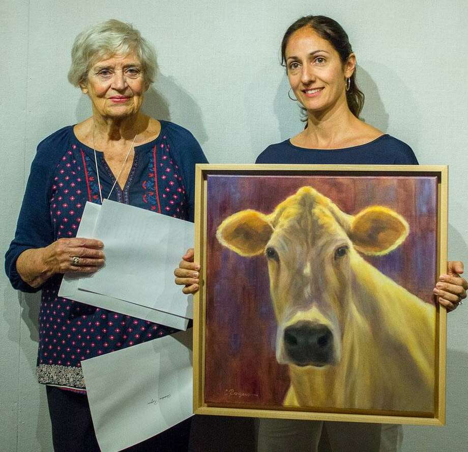 "KAA President Connie Horton, left, presents Chandre Rogers of New Milford with a KAA Award of Excellence for her oil painting ""Toffee,"" which is part of the association's current exhibit in the gallery. Photo: Courtesy Of Kent Art Association / The News-Times Contributed"