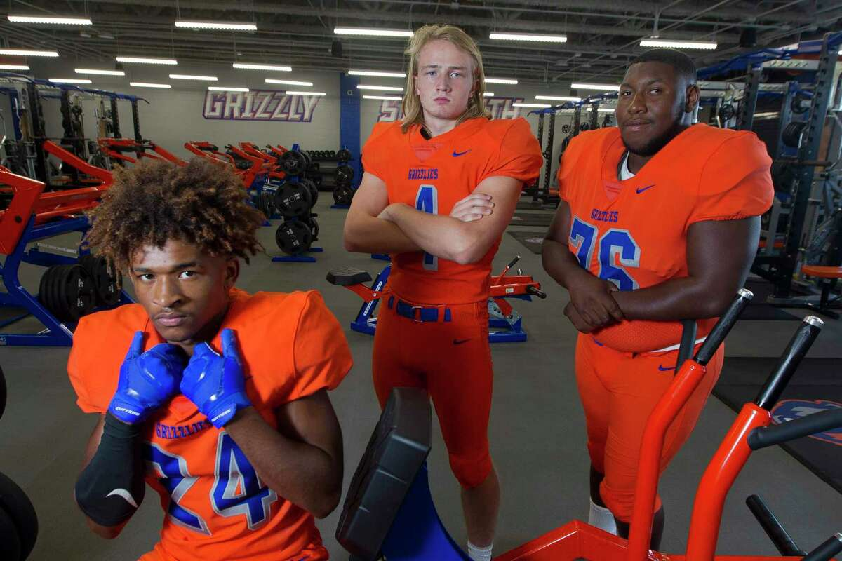 From left, David Wilkins, Hyrum Myers and Jordan Wilson pose for a portrait at Grand Oaks High Schools.