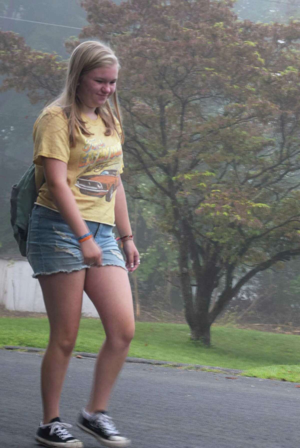 Marissa Gillette makes her way through the early morning fog on her way to the bus stop for her first day of school as a freshman at New Milford High School.