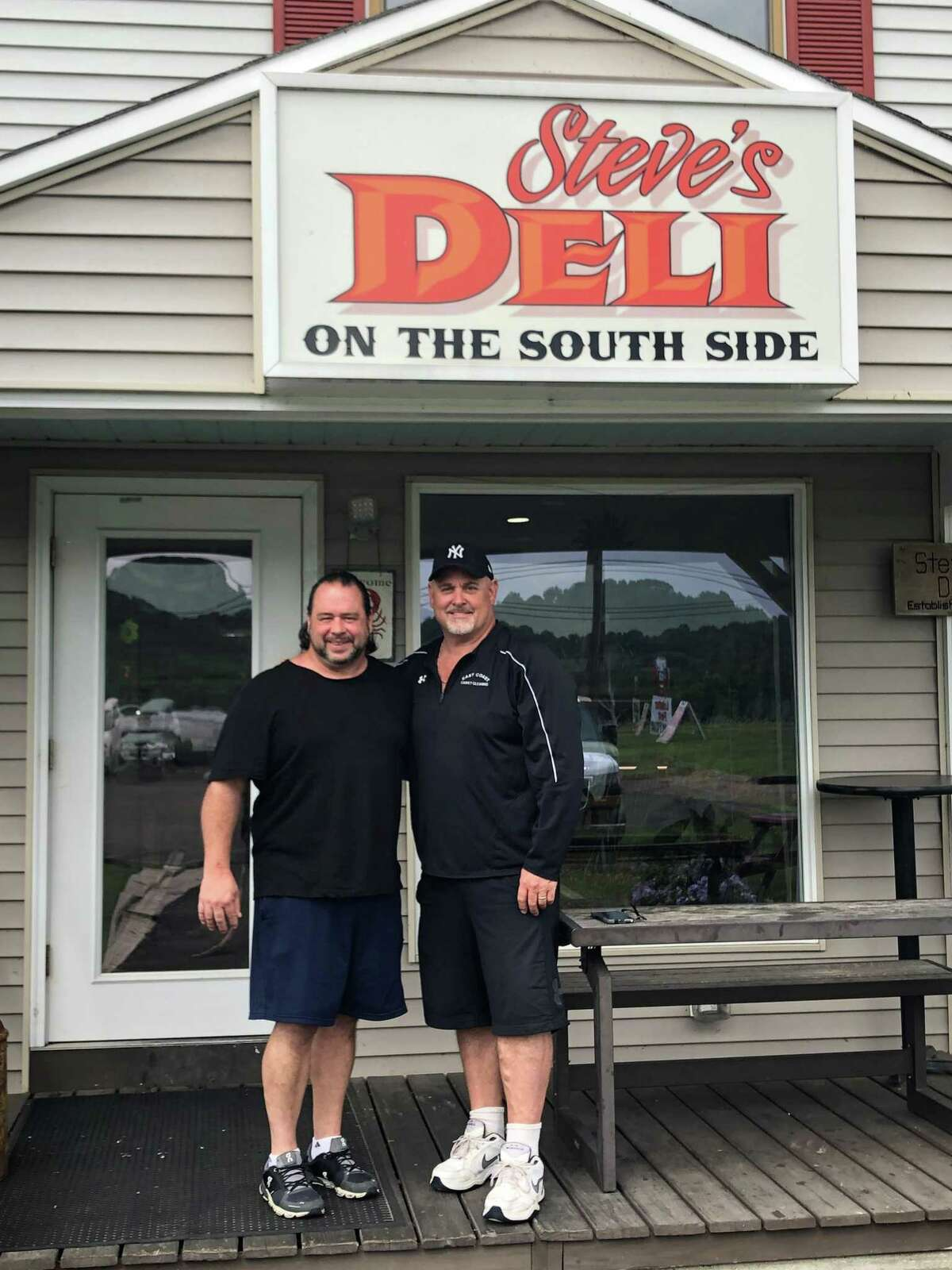 Steve Merkel, left, and Doug Skelly are longtime friends, having met around the time they each started their own business, Steve's Deli and East Coast Carpet & Upholstery Cleaning, respectively.