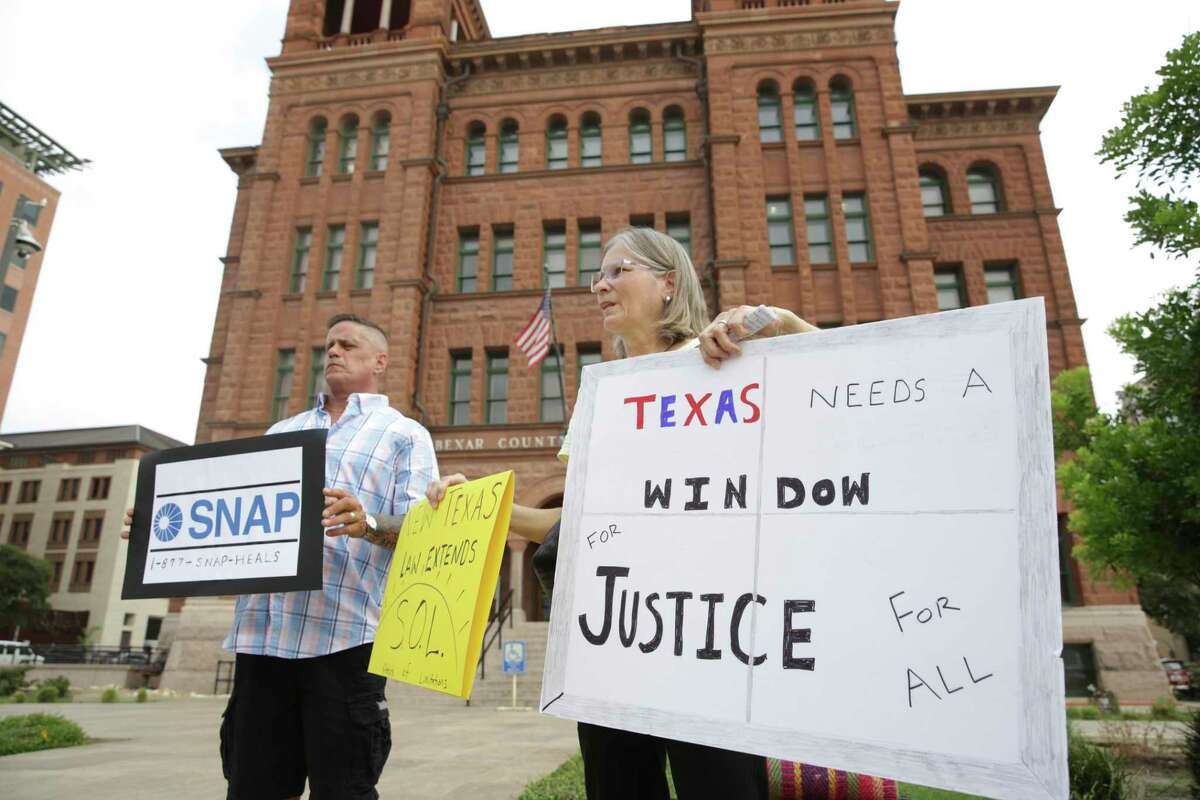 John Delaney, left, and Patti Koo, right, members of the San Antonio Chapter of SNAP, the Survivors' Network of those Abused by Priests held a press conference on the steps of the Bexar County Courthouse on Tuesday, Aug. 27, 2019.