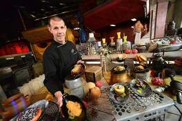 ORLANDO, FLORIDA - AUGUST 27: A Batuuan chef poses at the Docking Bay 7 quick service restaurant at the Black Spire Outpost at the Star Wars: Galaxy's Edge Walt Disney World Resort Opening at Disneys Hollywood Studios on August 27, 2019 in Orlando, Florida. (Photo by Gerardo Mora/Getty Images)
