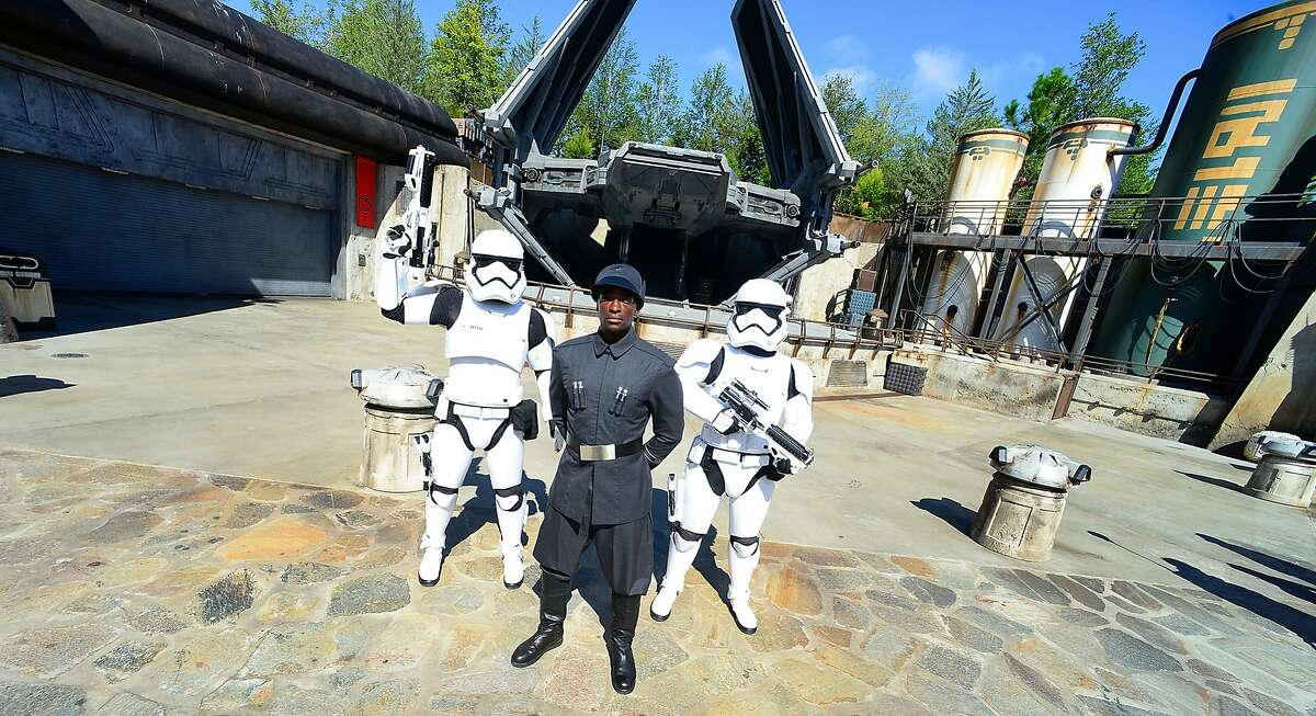 First Order officer (C) and Storm Trooper pose in front of the TIE Echelon at the Star Wars: Galaxy's Edge Walt Disney World Resort Opening at Disneys Hollywood Studios on August 27, 2019 in Orlando, Florida. (Photo by Gerardo Mora/Getty Images)